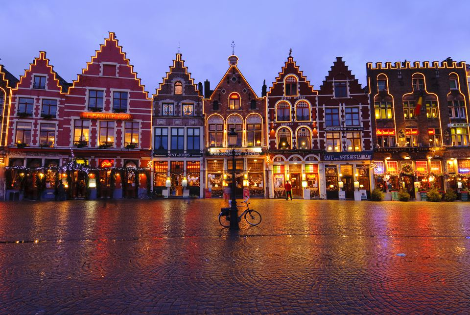 Medieval houses in Market Square (Brugge Markt) illuminated at night during Christmas, Bruges, Belgium
