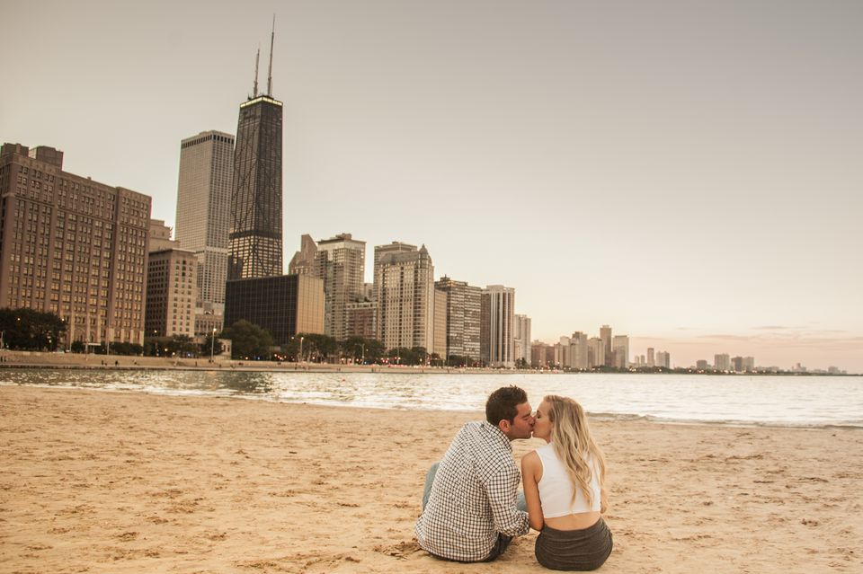Couple Kissing on Beach with Chicago backdrop