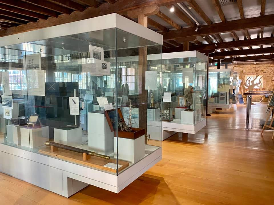 Display cases containing historical artifacts inside the museum