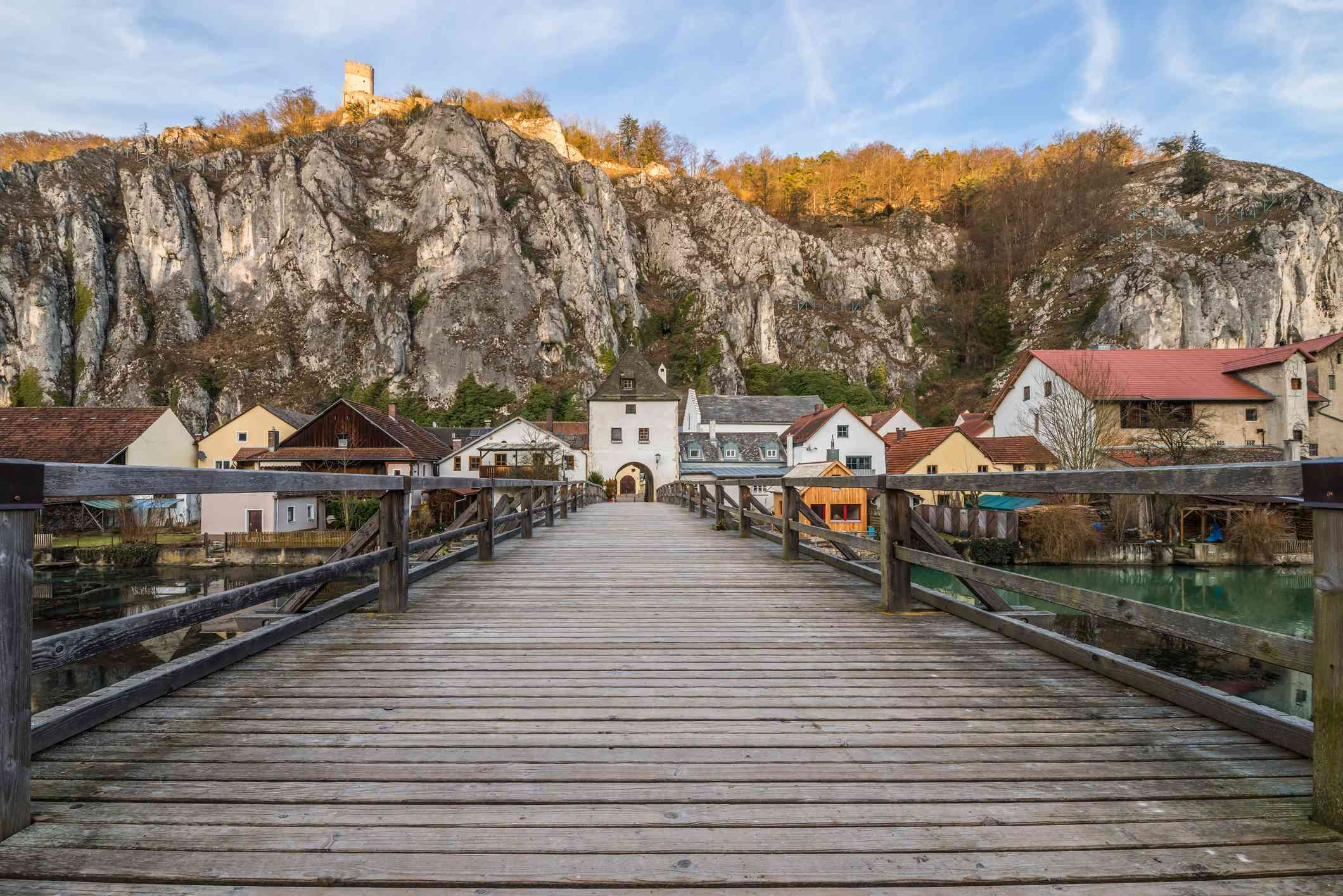 Altmühl valley with the bridge over the river and the castle on the rock, Germany