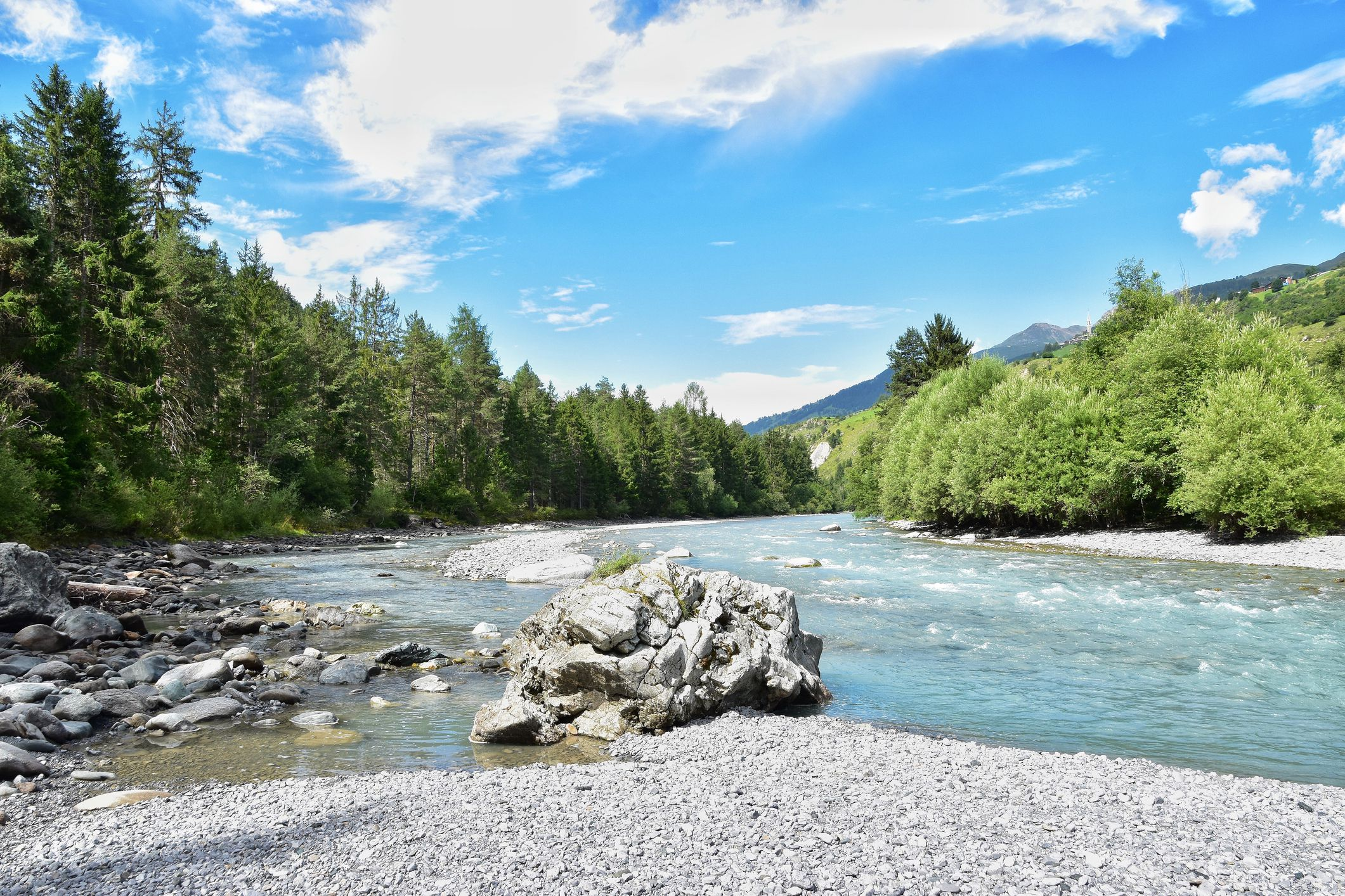 scenic river set against trees and blue sky
