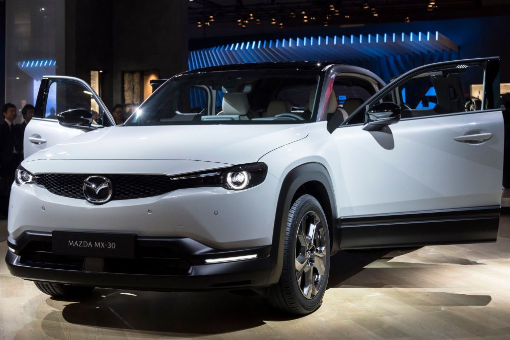 white Mazda suv with both front doors open