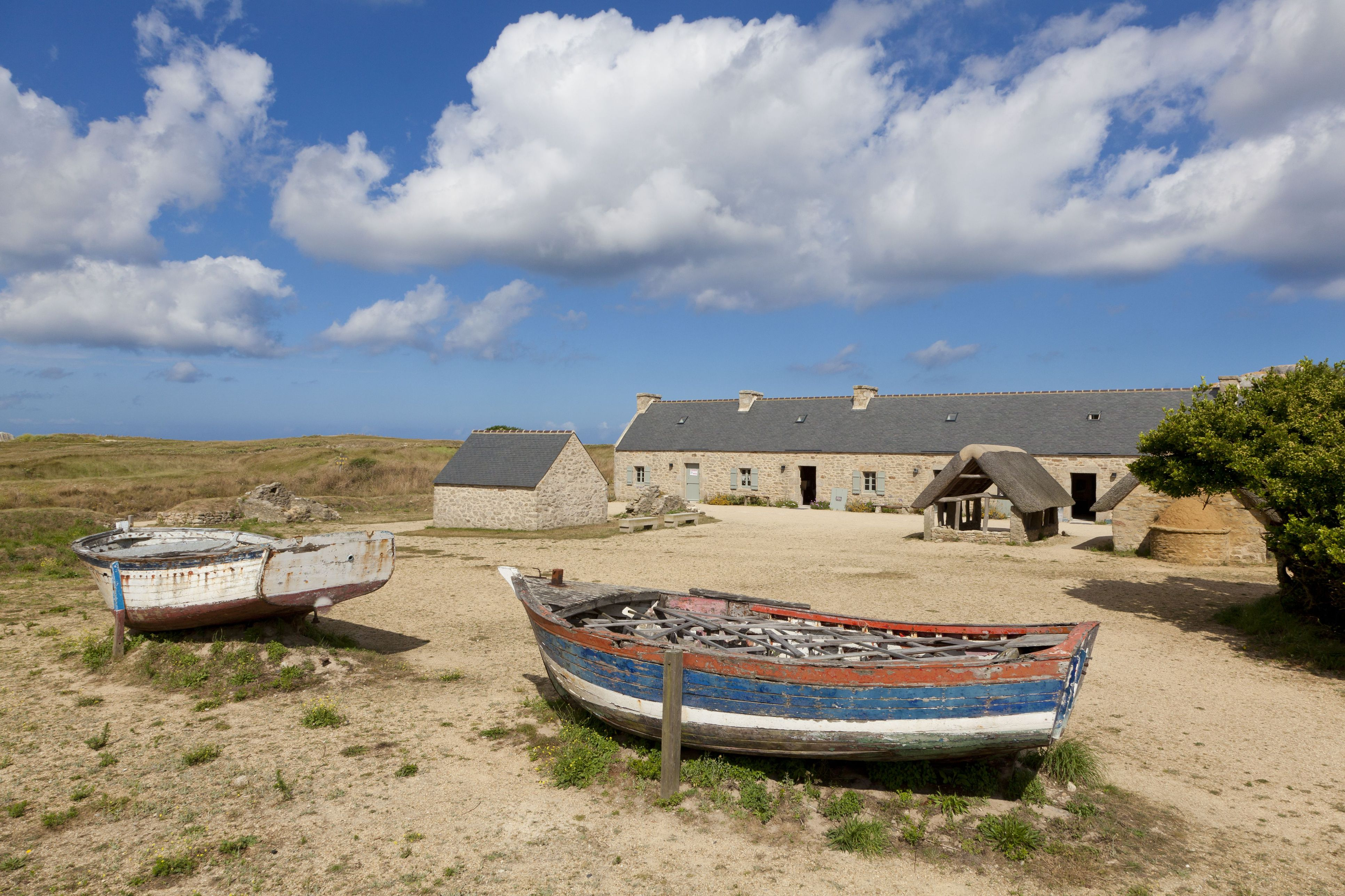 Beached rowboats near a home along the water in Ménéham, north Finistere