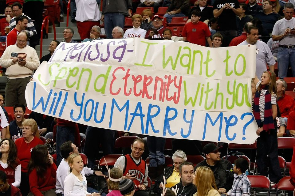 Marriage Proposal Banner at Baseball Game