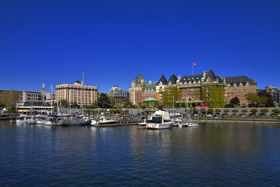 The iconic Empress Hotel sits at the head of the Inner Harbour, Victoria, British Columbia, Canada