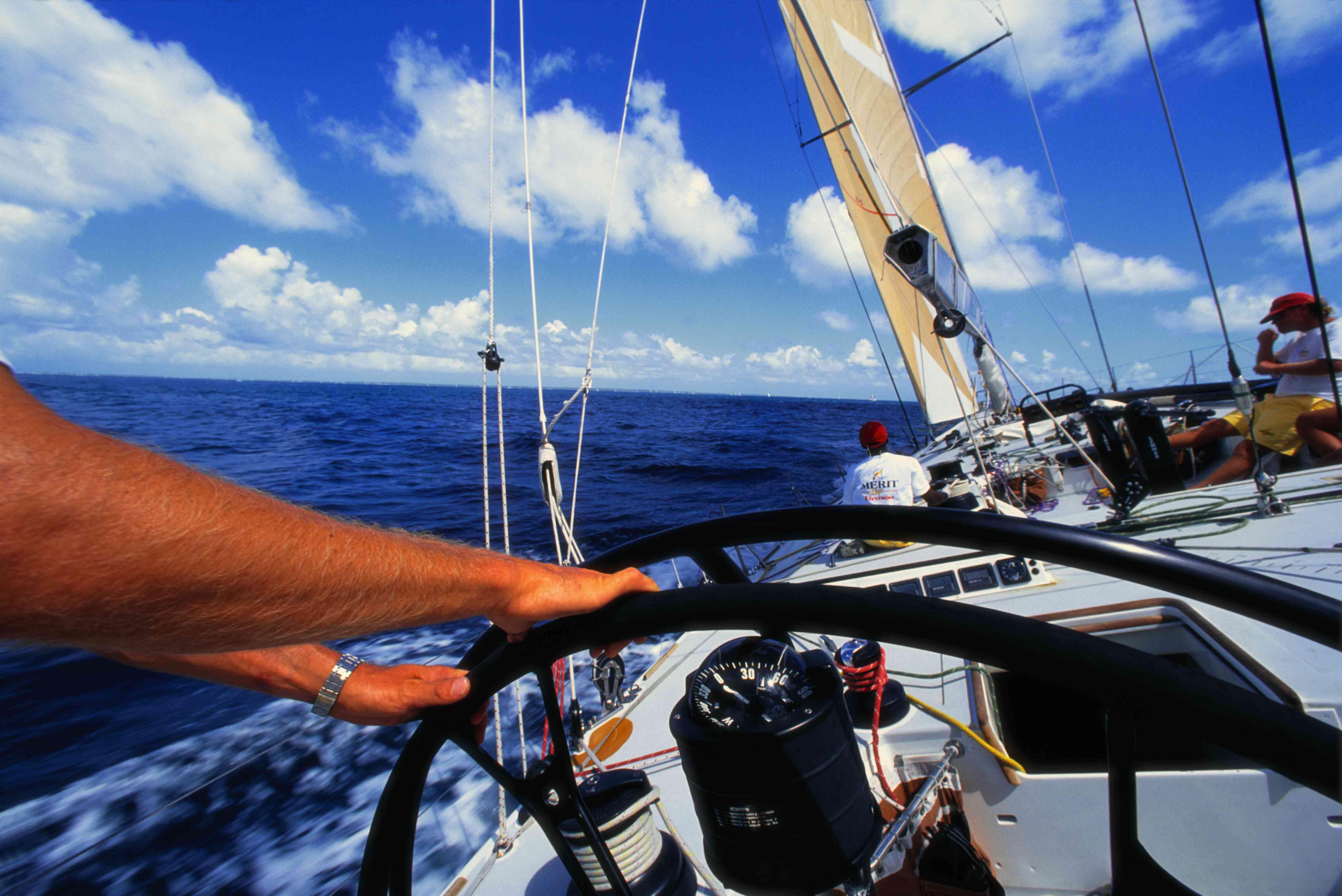 Sailor steering a Sailboat