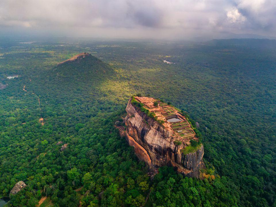 Aerial view of Sigiriya rock at misty morning, Sri Lanka. Drone photo.