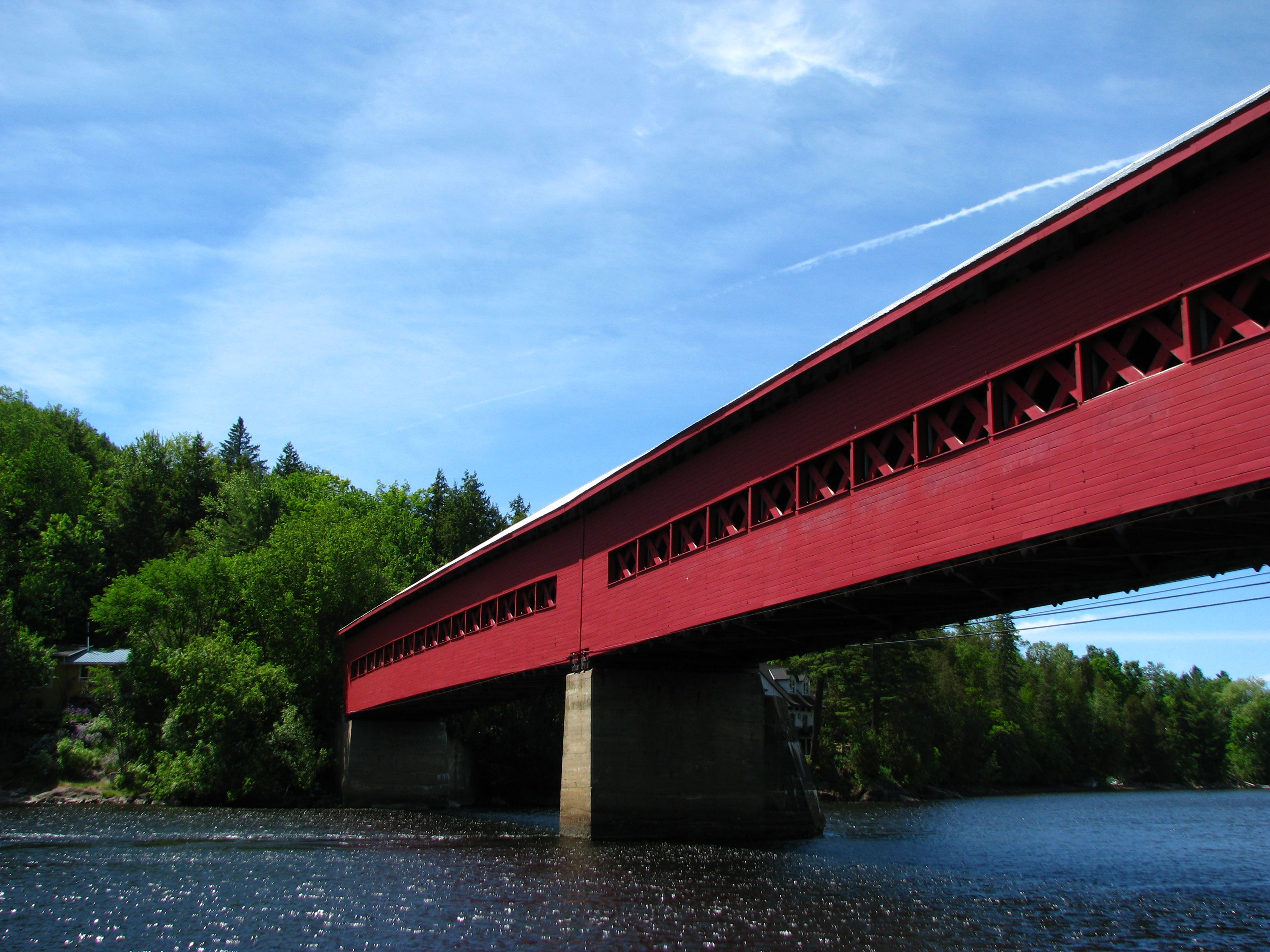 A covered bridge spans the Gatineau River in the charming town of Wakefield, Quebec, a popular and easy day trip from Ottawa