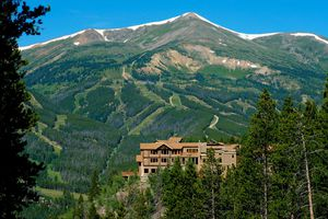 Outside view of The Lodge at Breckenridge with mountains in the background