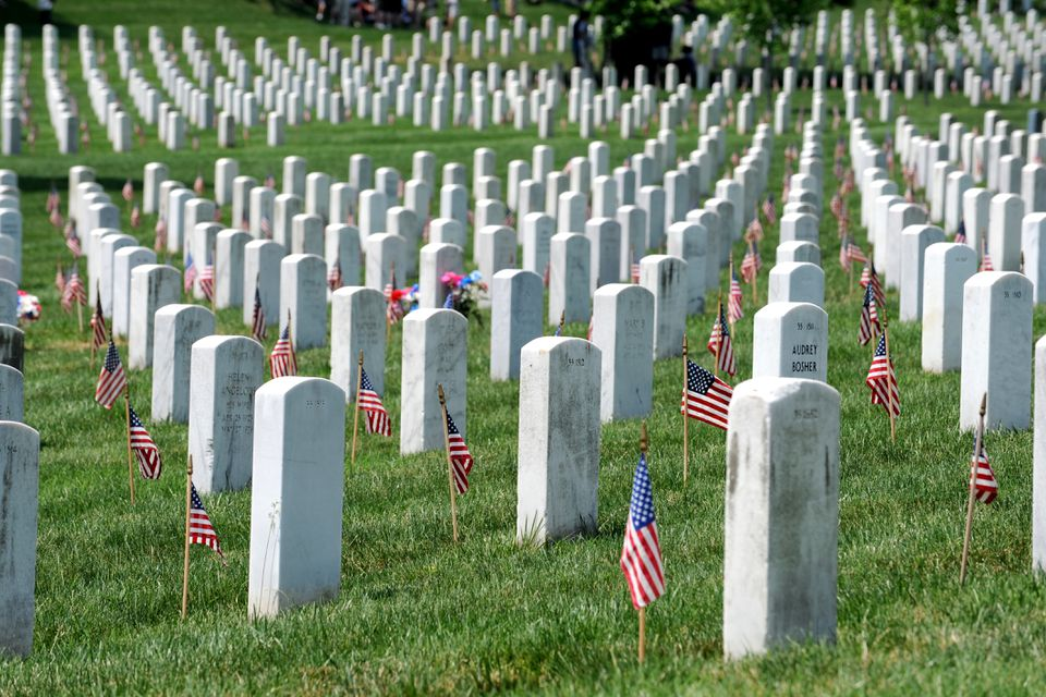 American flags decorating graves at Arlington National Cemetery in Arlington, Virginia
