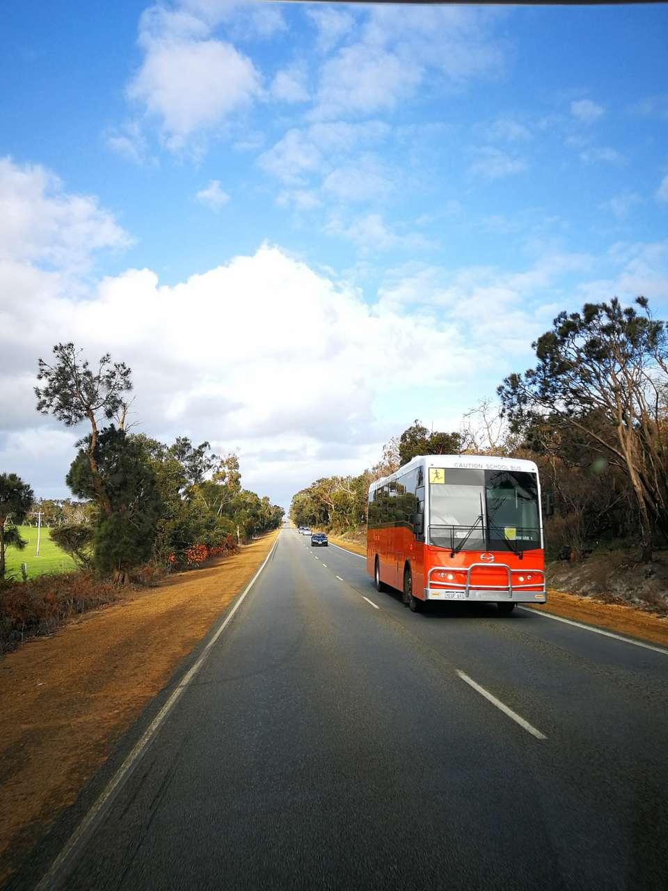 A bus driving through Austrlia