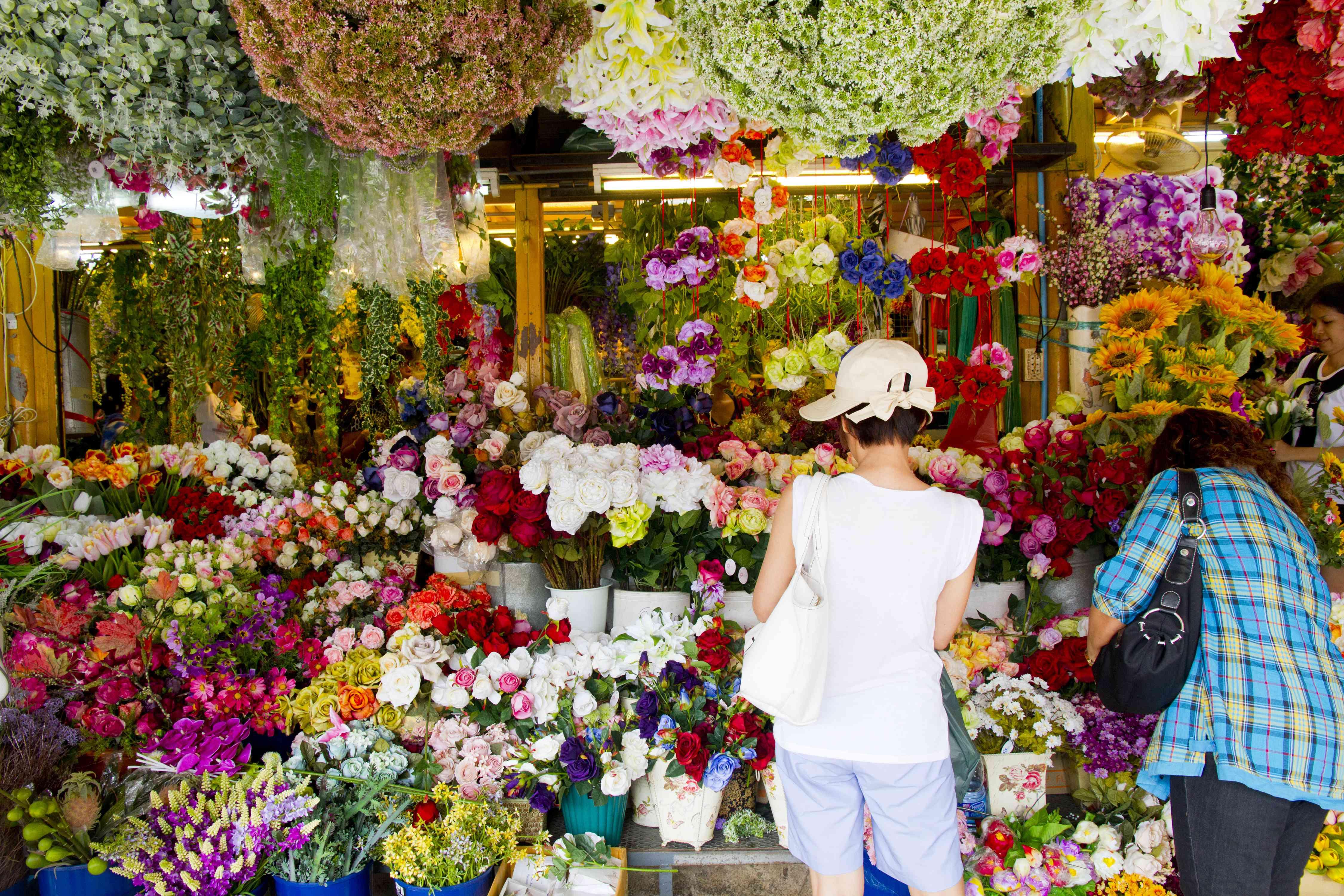 Women shopping at Pak Khlong Flower Market in Bangkok