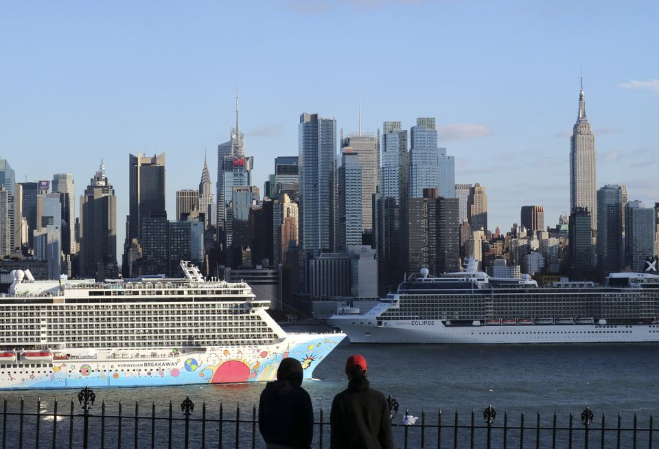 The Norwegian Breakaway cruise ship passes the Celebrity Eclipse in the Hudson River in front of the skyline of New York City...