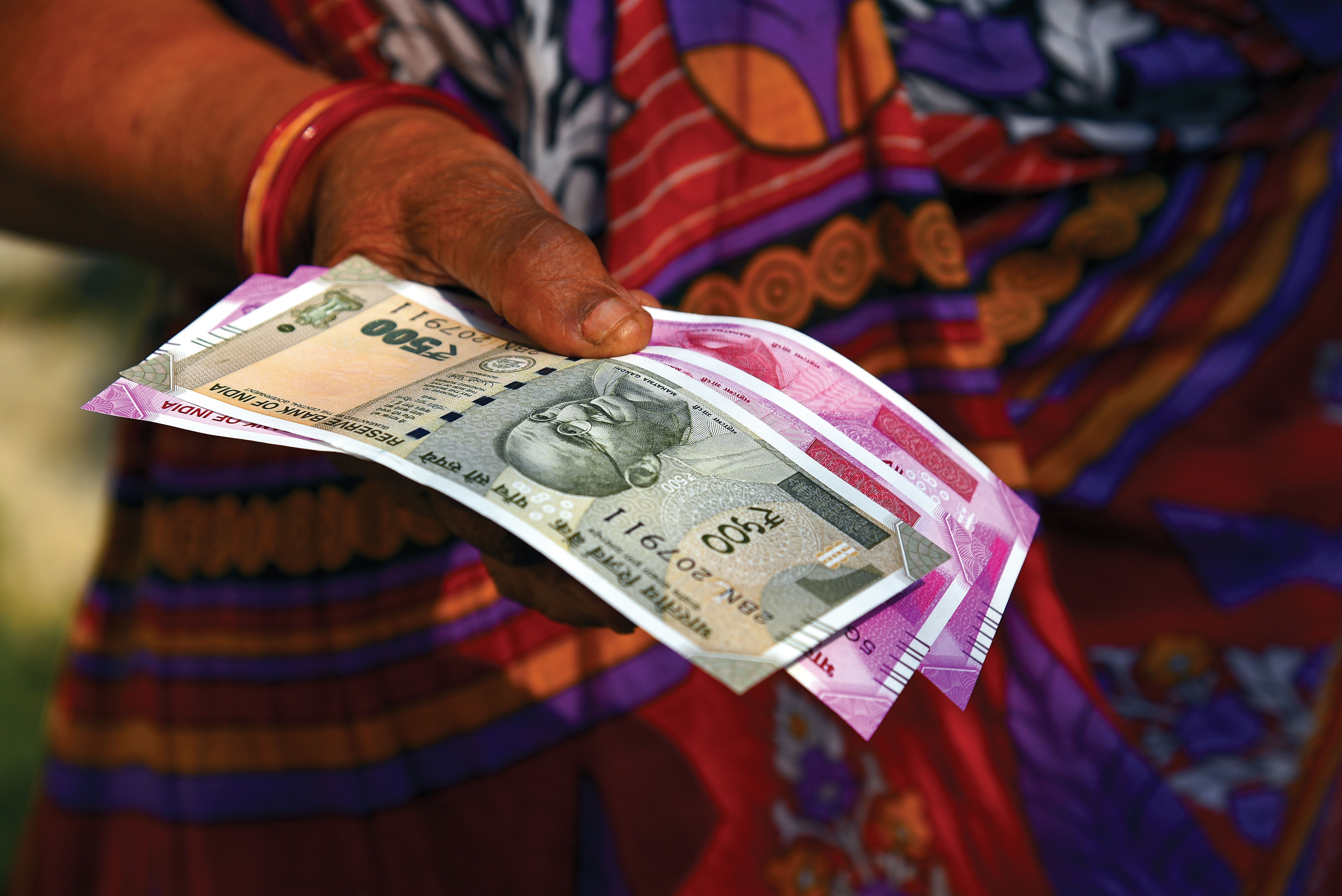 Woman holding money in India