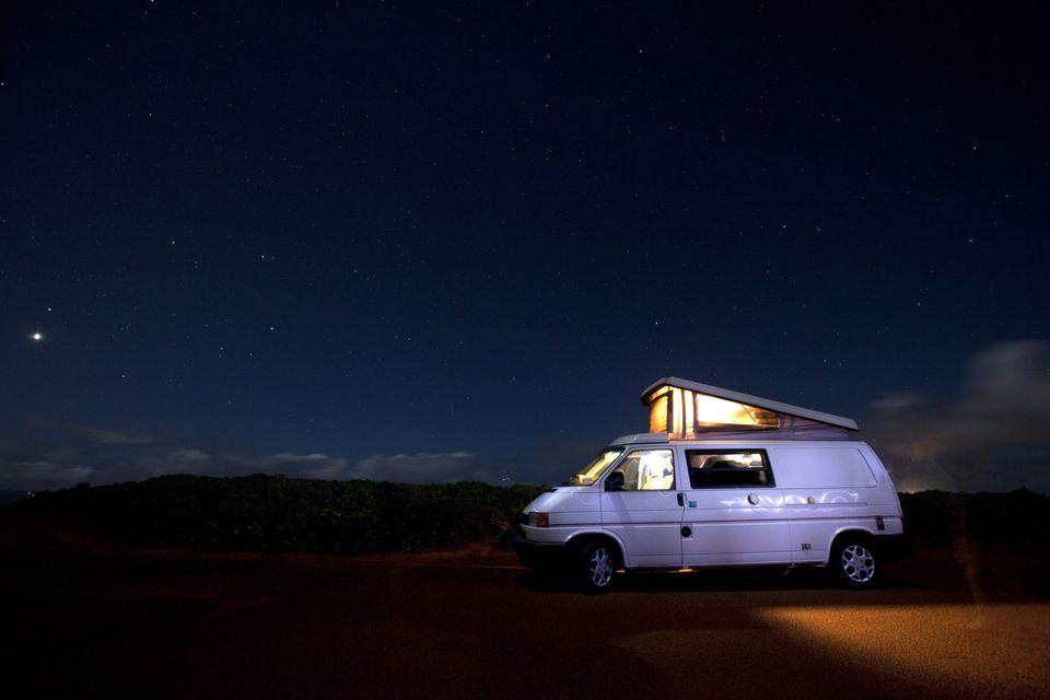 Camper under night sky