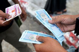 Money in Myanmar exchanging hands