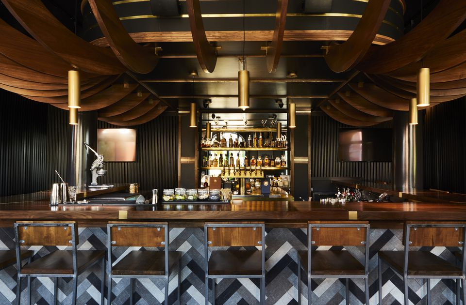Wraparound wooden bar at Sagamore Hill Lounge in portland maine