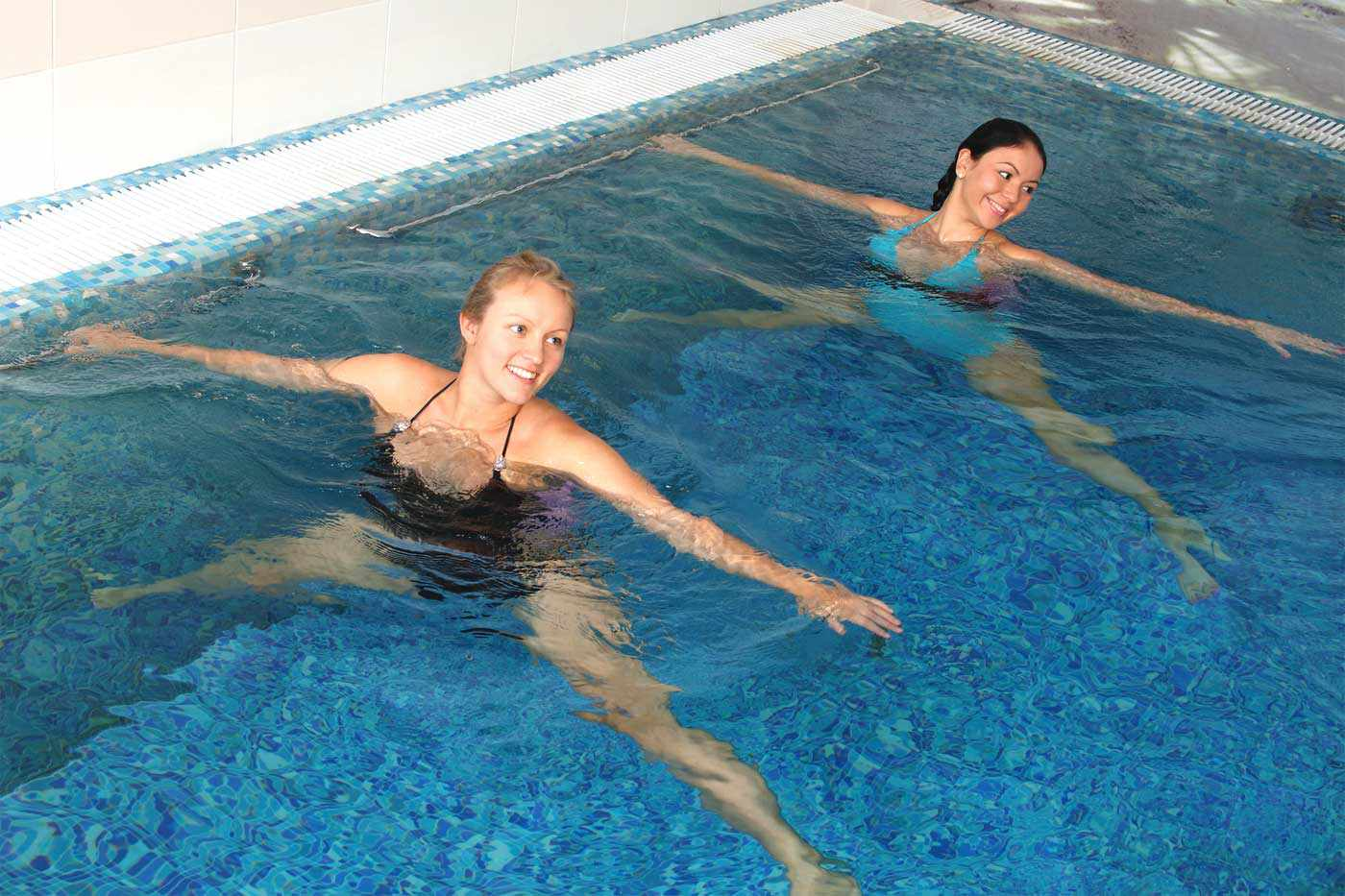 Women doing aquatic yoga
