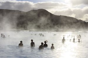 People enjoying a A sunny and relaxing day at the Blue Lagoon, Iceland