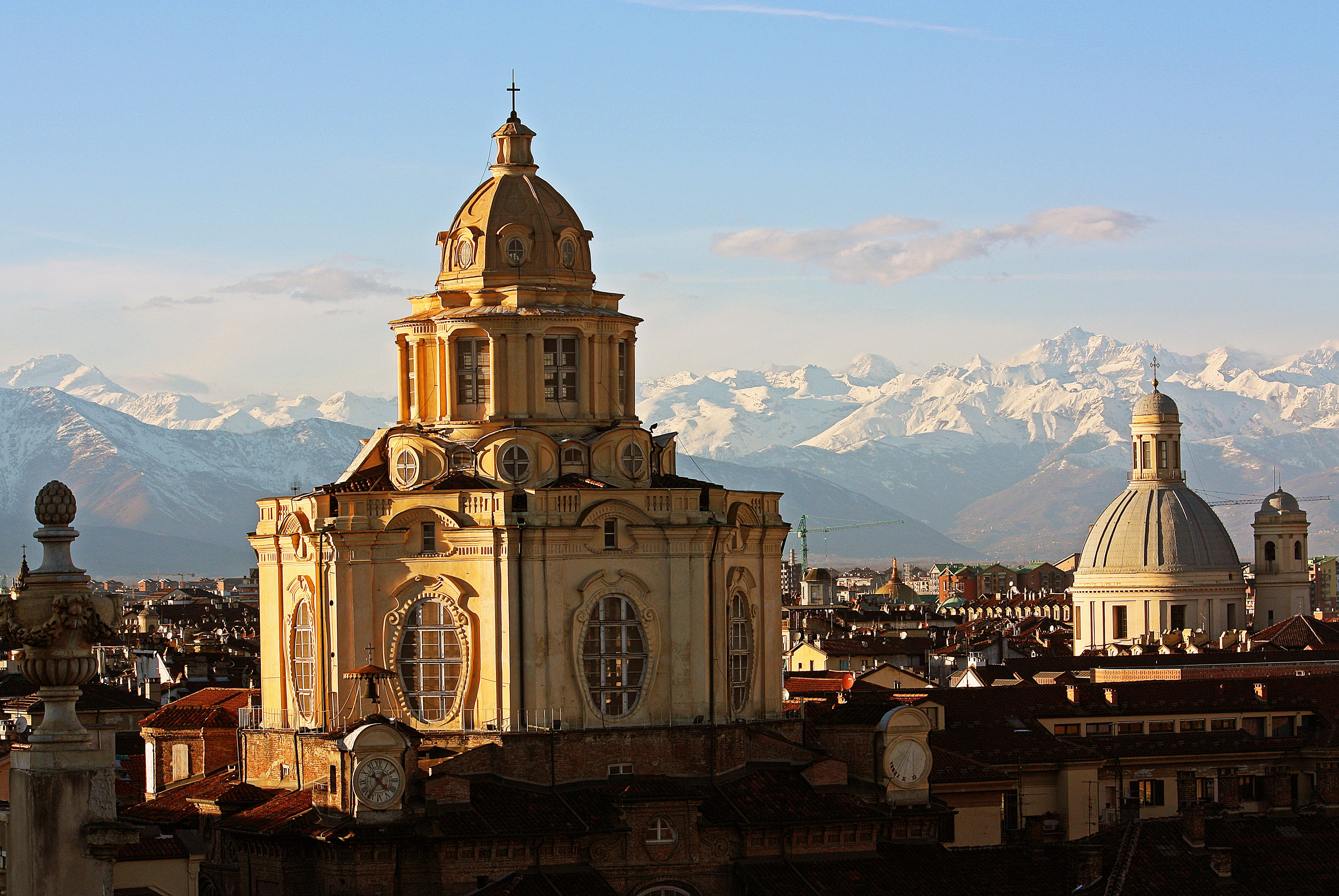 Roofs of Turin, Italy, with mountains in background