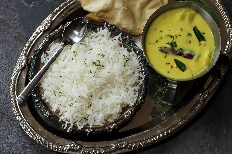 Gujarati Kadhi served with rice and papad, selective focus