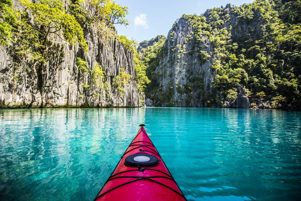 Kayak in a turquoise lagoon in El Nido, the Philippines