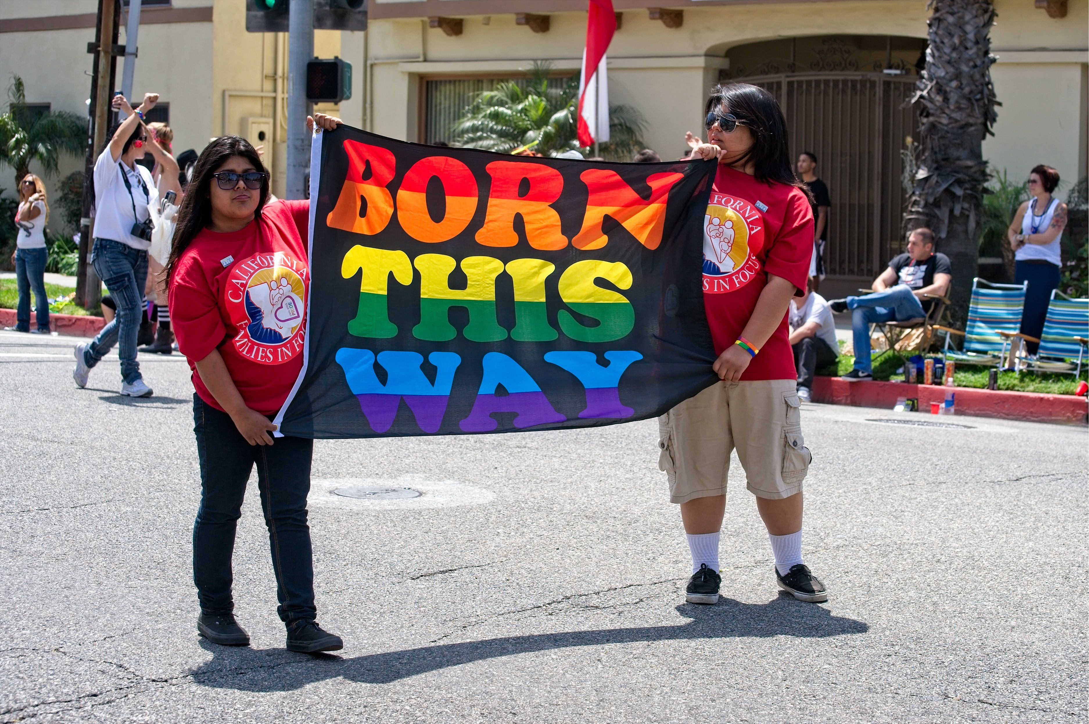 Women holding a 'Born This Way' at the 2012 Long Beach Lesbian & Gay Pride
