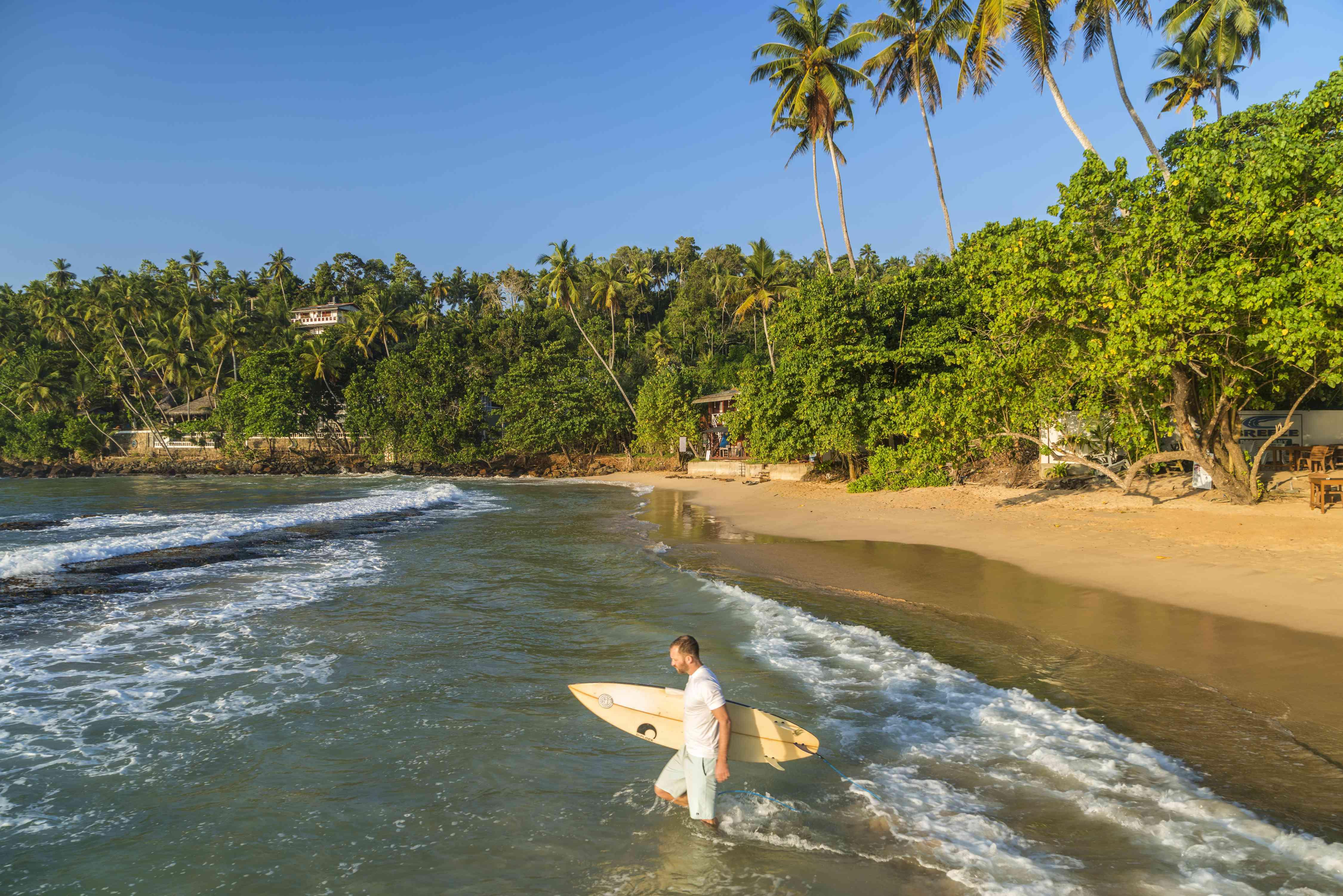 Surfer at Mirissa Beach in Sri Lanka