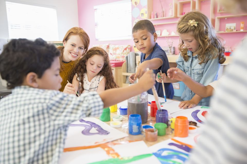 Students painting in class