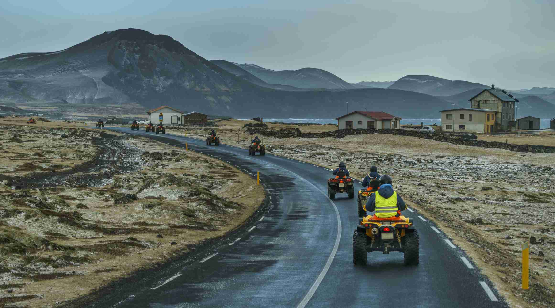 ATVs driving on the road in Iceland