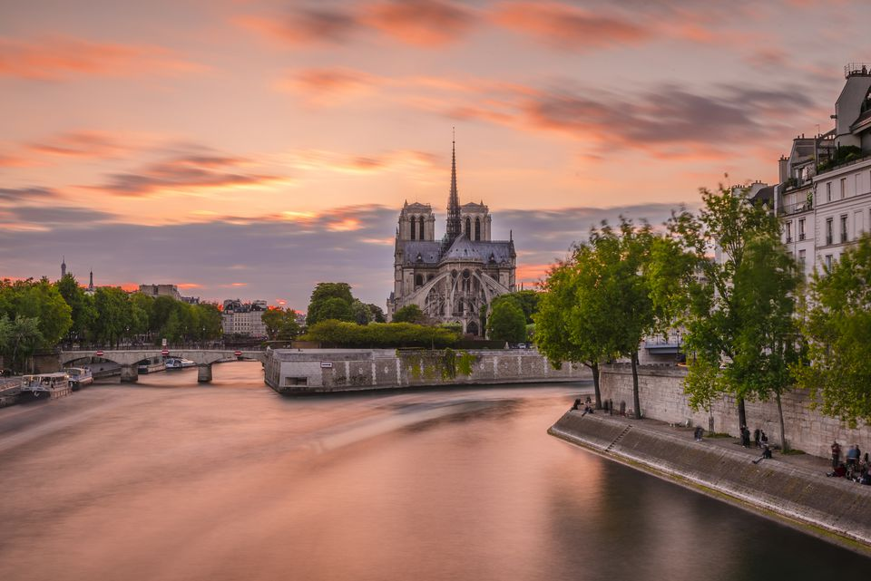 Romantic sunset over the Notre-Dame cathedral in Paris, France.