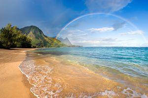 A rainbow over the beach in Kauai, Hawaii