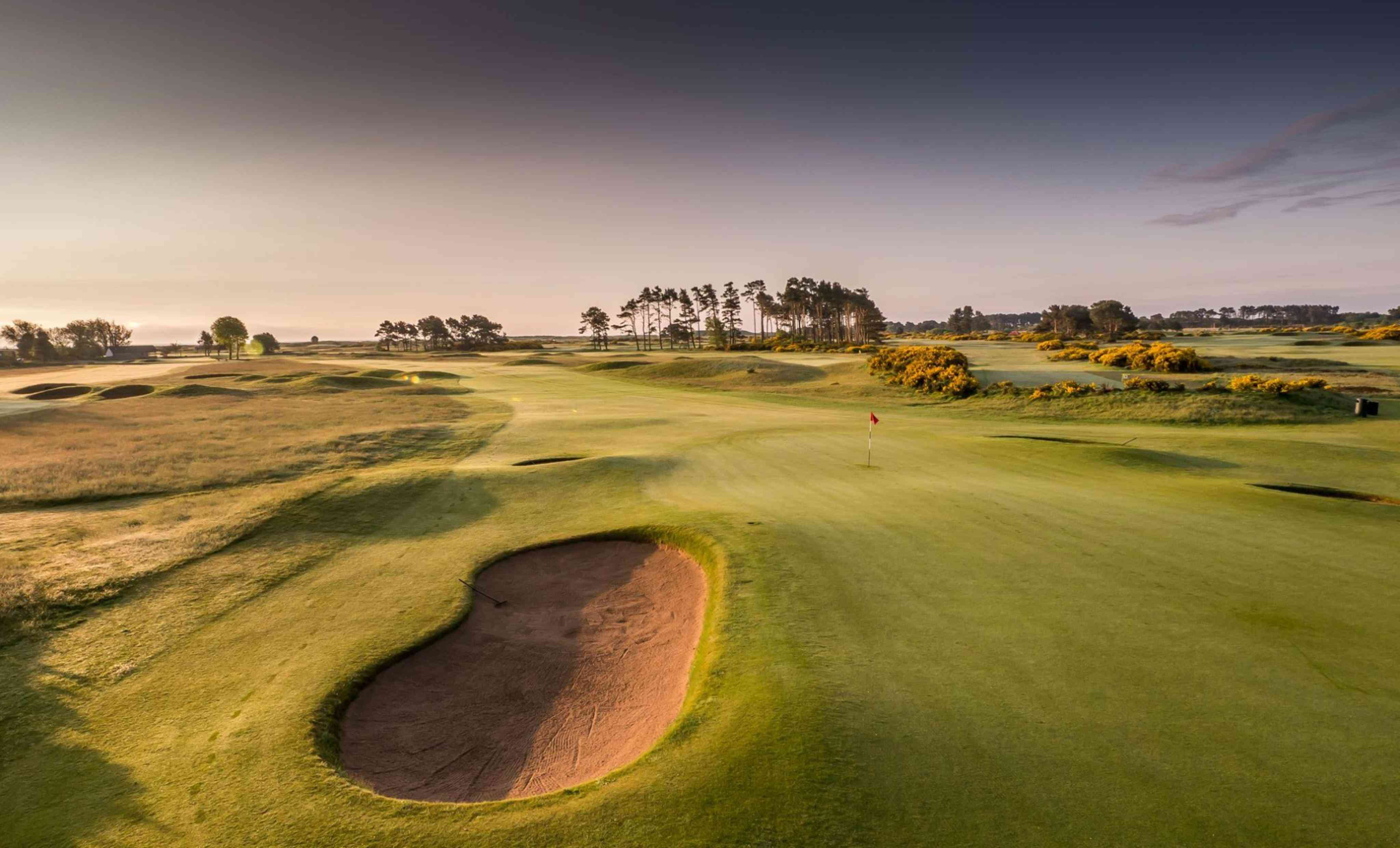 Golf course in scotland bathed in golden light
