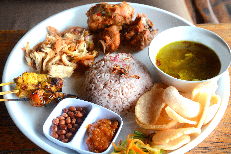 A nasi campur plate of varied foods