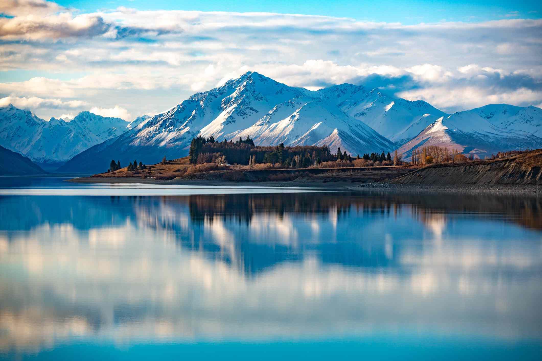 snowy mountains reflected in blue Lake Tekapo