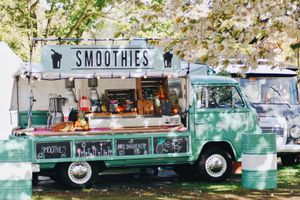 A picture of an old fashioned truck that has been turned into a food truck that makes fresh smoothies