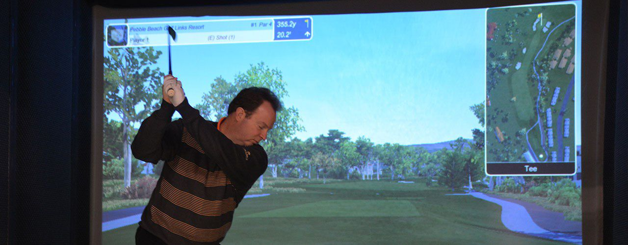 Indoor golf simulator at Okemo Mountain Resort