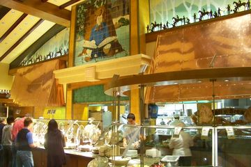 People deciding upon food while at the Storytellers Cafe at Disneyland Resort