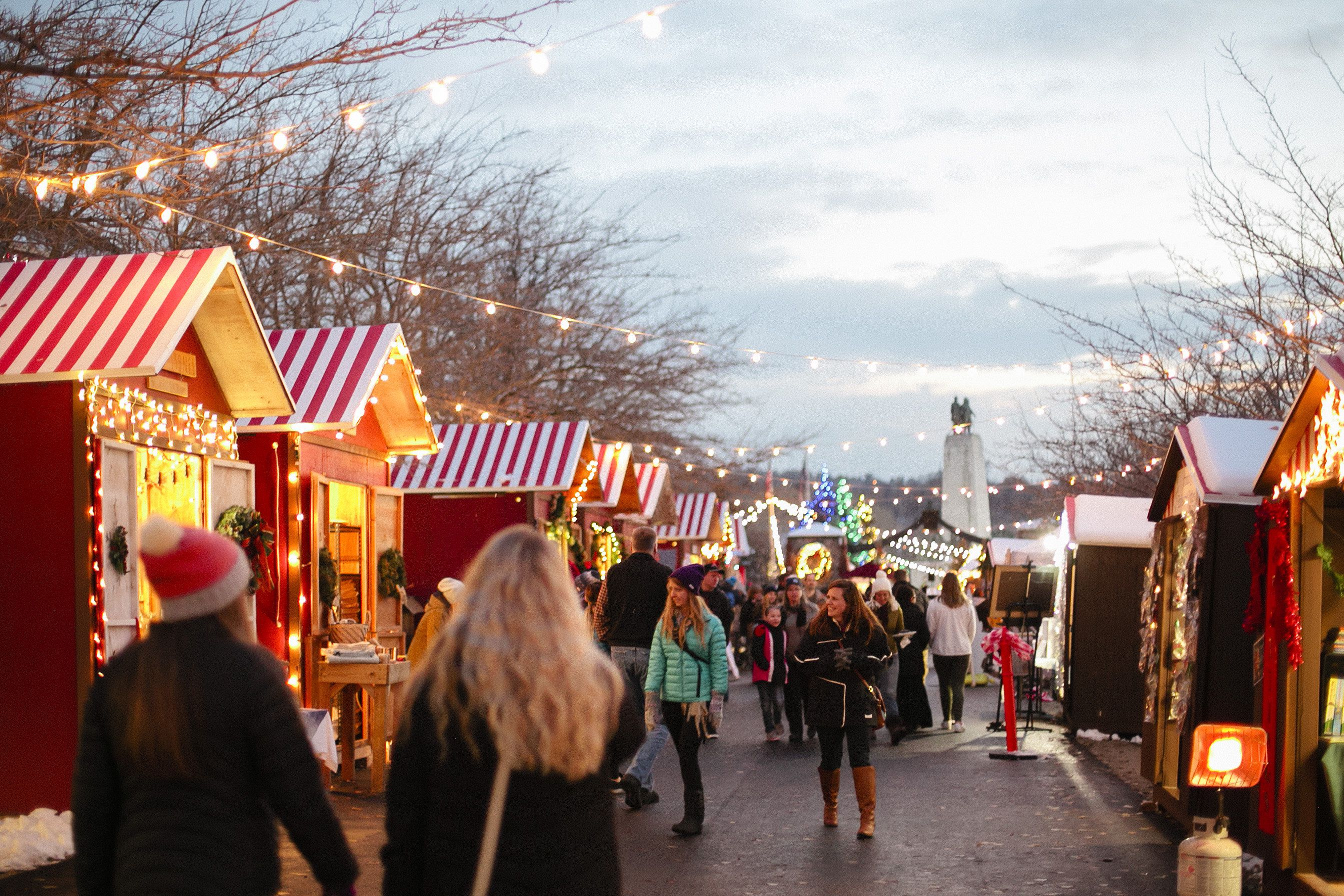 People shopping and walking around the Christmas Market in SLC